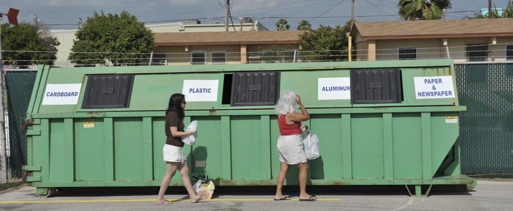 People Dropping Off Recycling